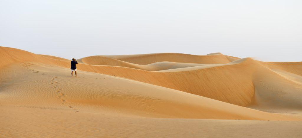 Ash Sharqiyah Tourist walking in the desert Sharqiyah Sands Ash Sharqiyah Oman 1