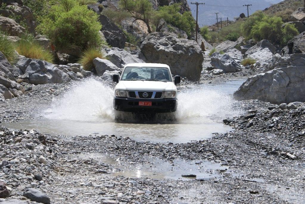 Wadis Car passing through a Wadi in Oman